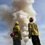 firefighters-stand-in-front-of-the-big-fire-smoke-408x544